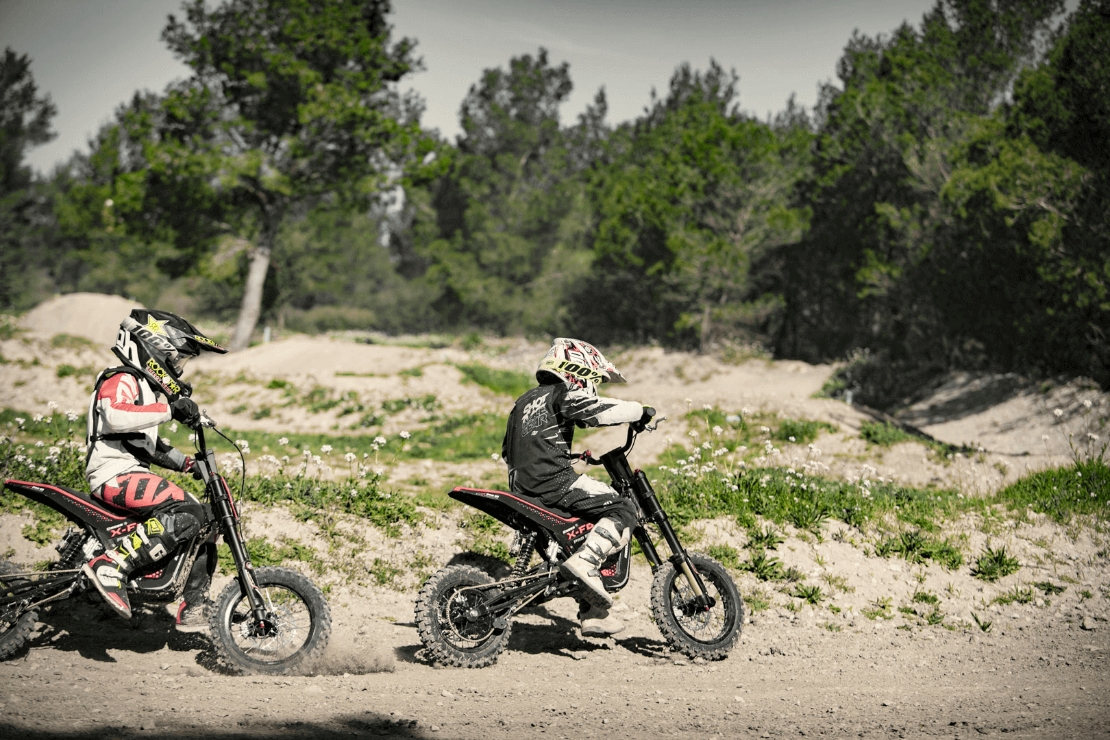 Two kids push the limits of the X-Force Pro 50 on a motocross track.